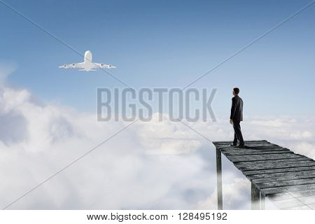 Businessman stand on berth