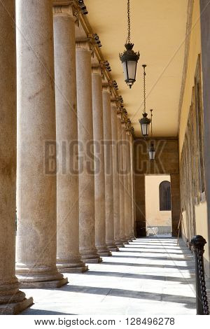 Ancient stone colonnade in Italian city of Parma