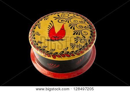 Russian wooden casket in Mezen painting isolated on black