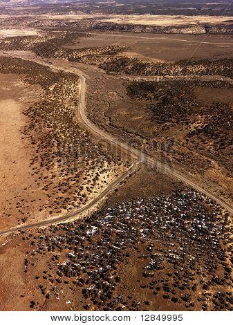 Aerial view of a of rural, desert landscape with roads running through it. Vertical shot.