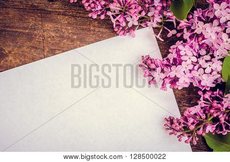 Beautiful lilac flowers on a wooden vintage board. Greeting card with place for text Happy Mother's Day. Retro style toned picture. Mother's day. Mothers Day gift. Mothers Day.