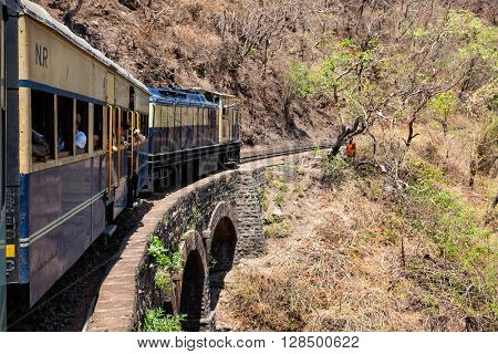 HIMACHAL PRADESH, INDIA - MAY 12, 2010: Toy train of Kalka ??Shimla Railway - narrow gauge railway built in 1898 and famous for scenery and improbable construction. It is UNESCO World Heritage Site