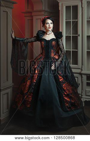 Retro baroque fashion woman in a magnificent dress.