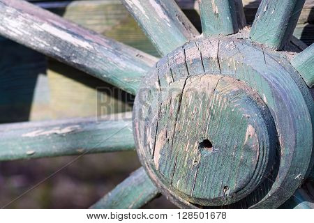 fragment of a big wooden wheel with spokes for an ancient cartage and for the cart or the vehicle