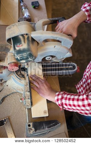 Circular Saw. Carpenter Using Circular Saw for wood woodworking shop the concept of a hobby handmade