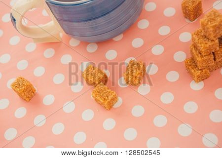 Blue Cup Of Tea And Lump Sugar On Pink Background