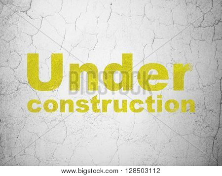 Web development concept: Yellow Under Construction on textured concrete wall background