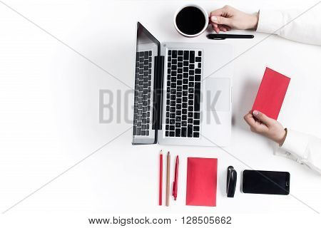 Business concept. Comfortable stylish workplace with gadgets at the white background