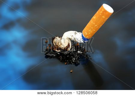 Cigarette on x-ray lung, close up
