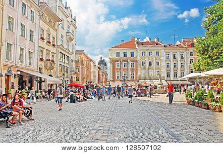 LVIV, UKRAINE - JULY 17, 2015: Market square - historical and tourist centre of the town in Lviv, Ukraine. It is UNESCO World Heritage Site
