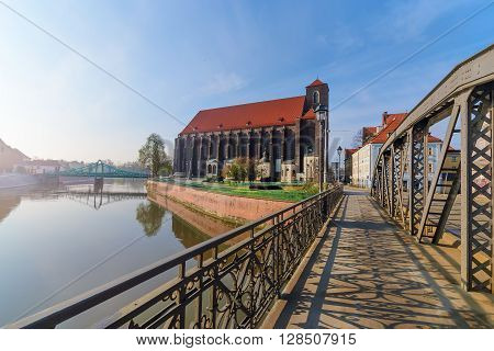 View on the church of the Virgin Mary from the Millstone bridge in Wroclaw. Poland.