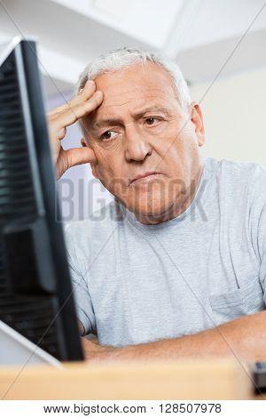 Depressed Senior Student Looking At Computer