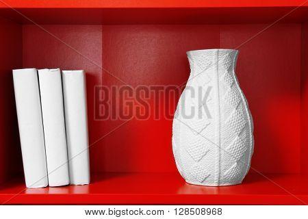 Bookcase with home decor closeup