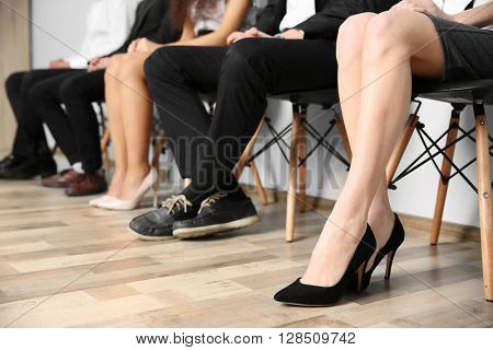 Group of people sitting on chairs indoors