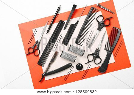 Barber set with tools and pen on bright paper background