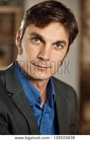 Closeup portrait of confident businessman looking at camera.