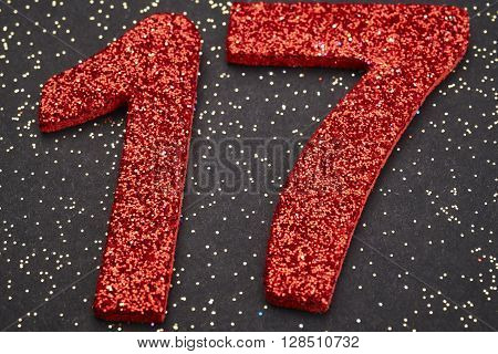 Number seventeen red color over a black background. Anniversary. Horizontal
