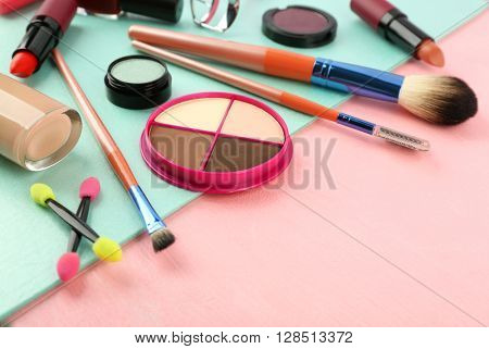 Makeup set with brushes and cosmetics on bright background
