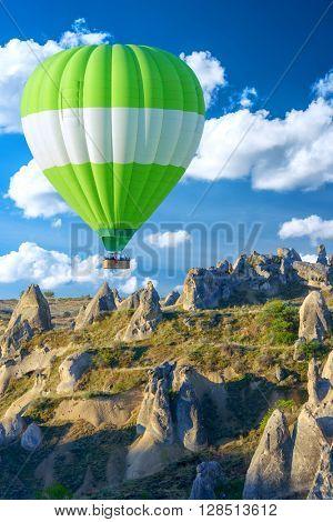 Balloon silhouette in the sunrise sky. Cappadocia, Turkey