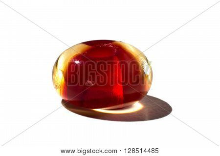 Hand made brown transparent glass bead on white background