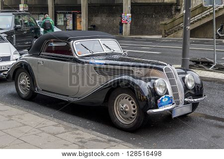 Cologne, Germany - May 16: This is the old vintage luxury car BMW 327 Cabriolet on-street parking May 16, 2013 in Cologne, Germany.
