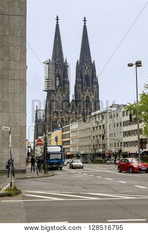Cologne, Germany - May 16: This is a street leading to the station square and the main entrance to the Cologne Cathedral May 16, 2013 in Cologne, Germany.