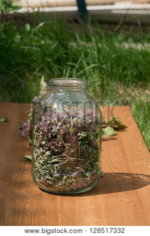 glass jar with dried clover
