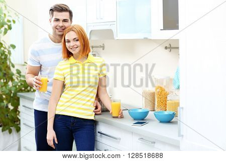 Happy couple have healthy breakfast on the kitchen