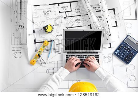 Architect sketching construction project, top view
