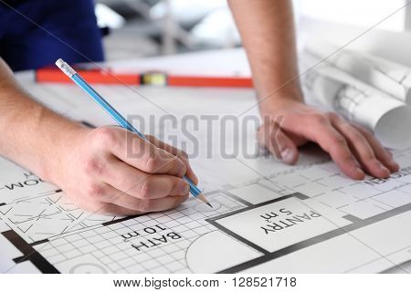 Architect sketching construction project closeup