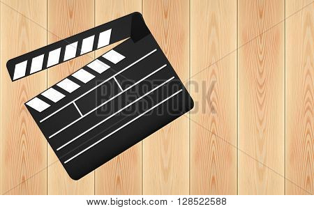 Movie clapperboard on the wooden plank background