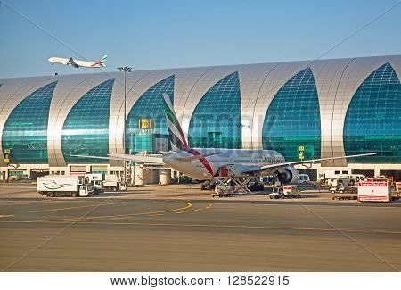Dubai - February 20:  Planes preparing for take off at Dubai Airport on February 20, 2016 in Dubai, U.A.E. Dubai airport is home port for Emirates Airlines and one of the biggest world hubs.