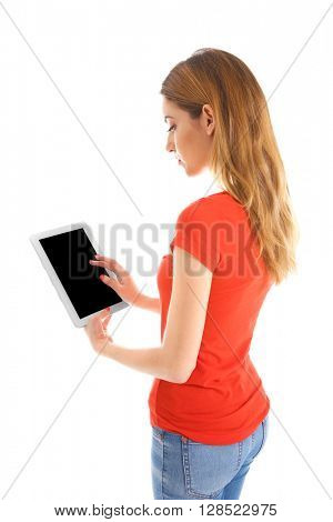 Young woman in red tee-shirt using tablet, isolated on white