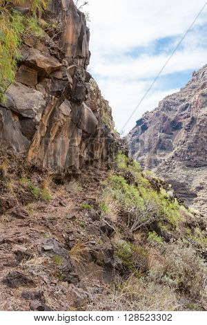 Hike in the Argaga Canyon, The Barranco de Argaga is next to the Valle Gran Rey. The trail is heavy to hike and with the steep slopes a bit dangerous to walk.  It is a steeply path through the gorge