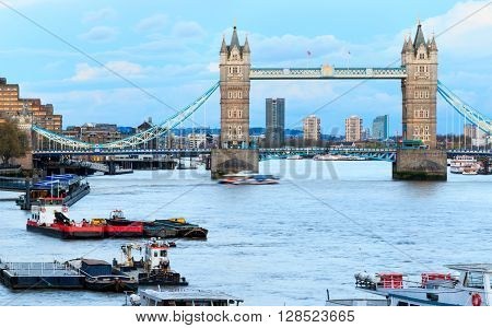 View of Tower Bridge and Thames river in London against cumulus clouds in a blue sky