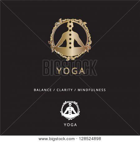 LUXURY GOLD YOGA LOGO / ICON ON BLACK BACKGROUND