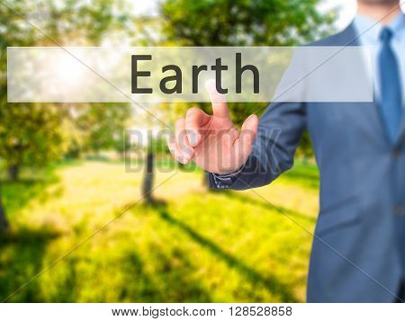 Earth - Businessman Hand Pressing Button On Touch Screen Interface.