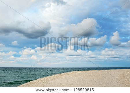 cloudy sky and blue sea port of Ostuni Apulia mediterranean Italy