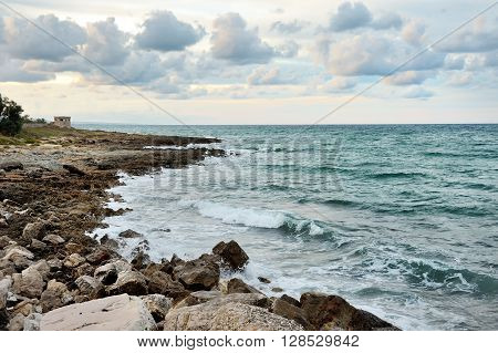 Ostuni sea on the rocks in a summer cloudy day Apulia southern Italy