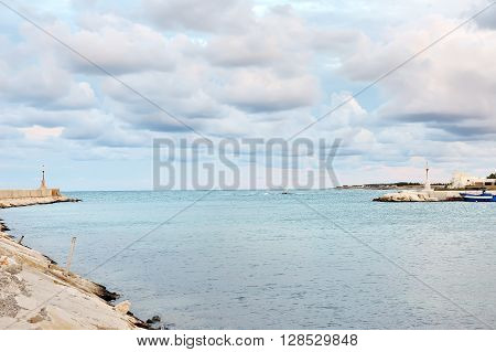 blue sea and cloudy sky Ostuni port Apulia Mediterranean sea Italy