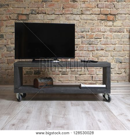 modern wooden tv unit in the loft interior