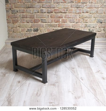 modern wooden table in the loft interior