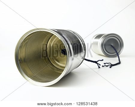 Tin Can Telephone with cut string isolated on a white background