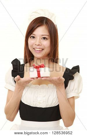 young Japanese woman wearing french maid costume offering a gift