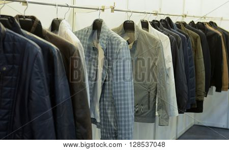 man suit ,Shirts with ties on wooden hangers