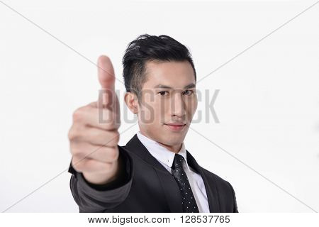 Happy smiling young business man with thumbs up gesture,