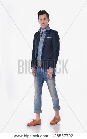 Full body Portrait of young men in jeans walking in studio