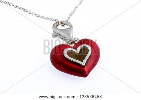 Red enamel painted heart necklace on white background