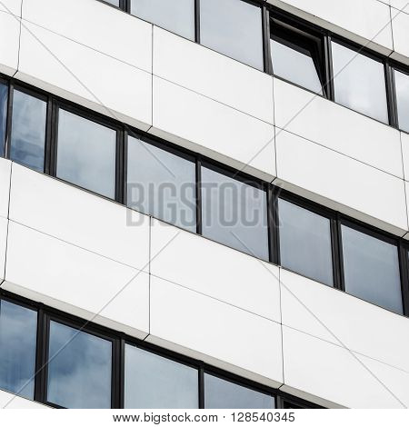 Close-up fragment of modern office building of steel and glass. Abstract modern architecture. Close-up of modern business skyscraper.