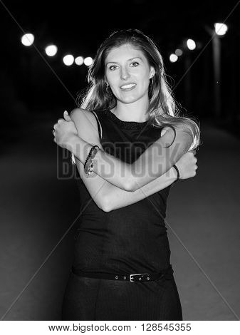 black and white blond woman with crossed arms